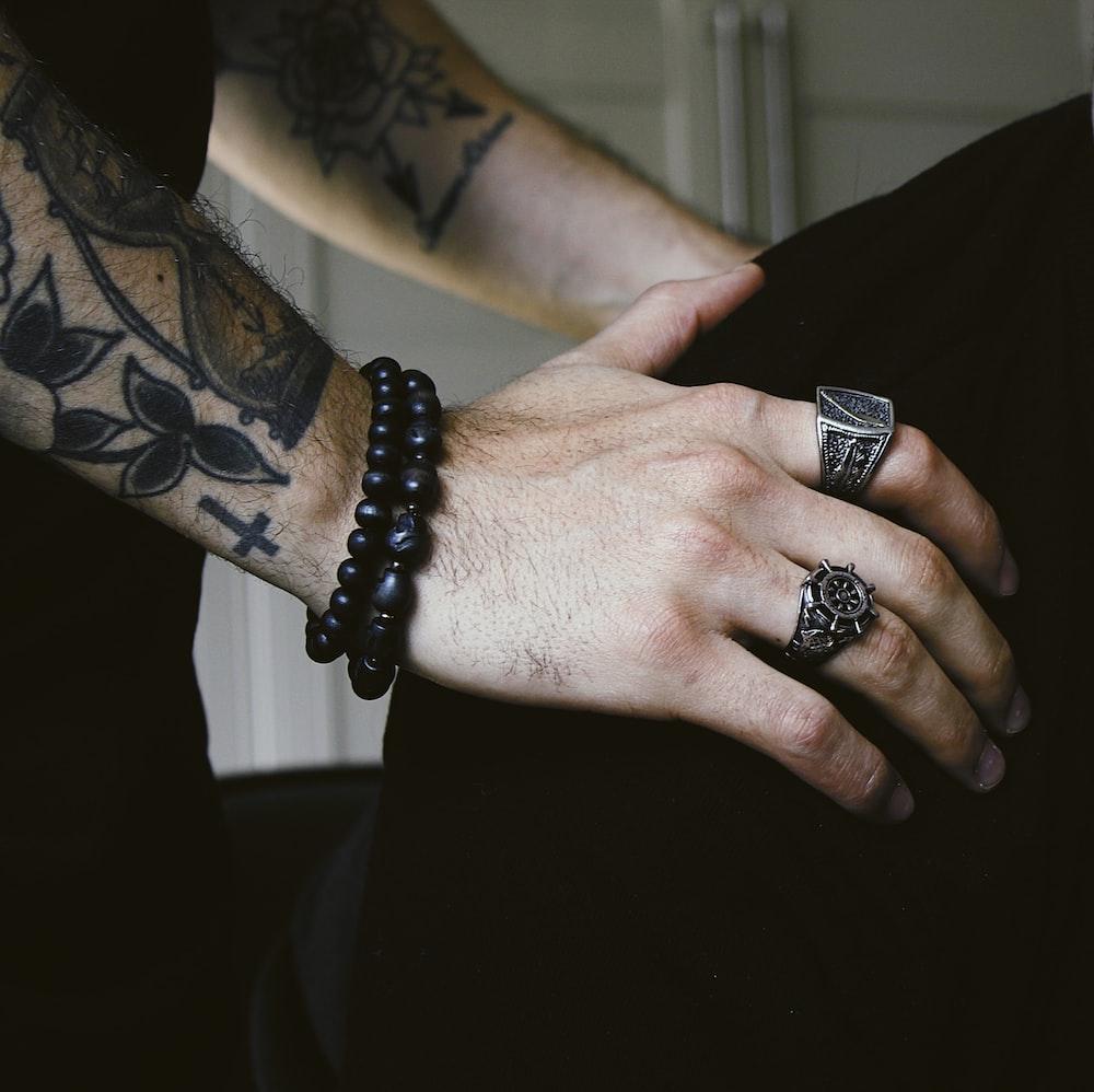 person wearing black bracelet