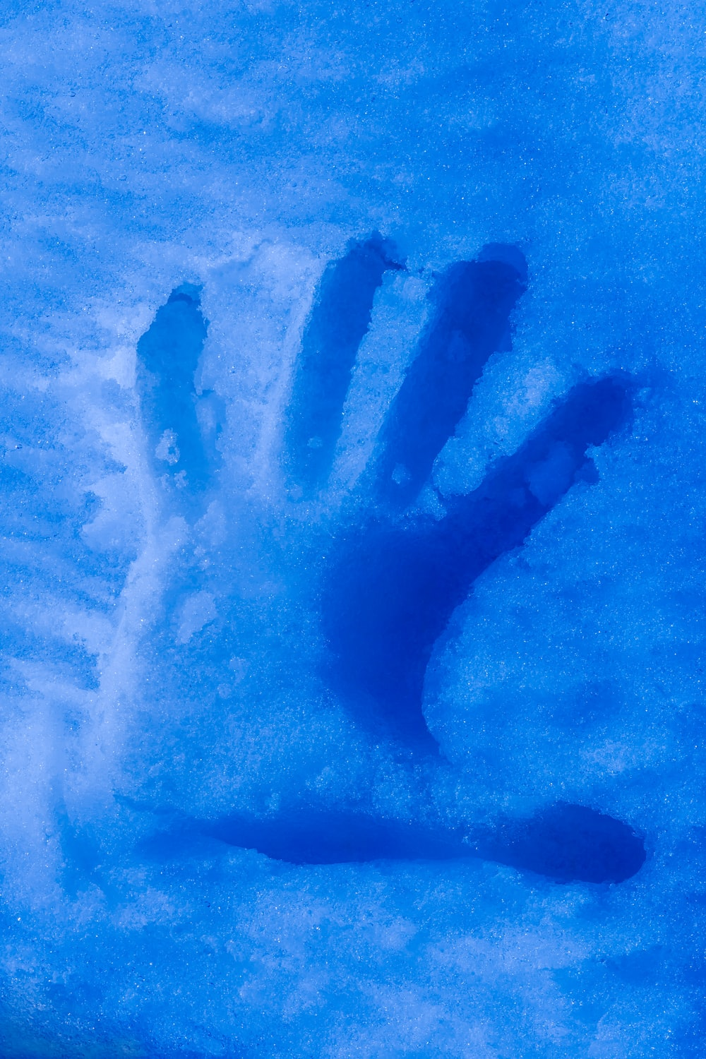 left hand on icy surface
