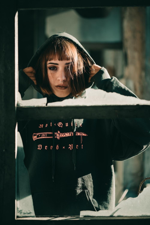 woman wearing black pullover hoodie