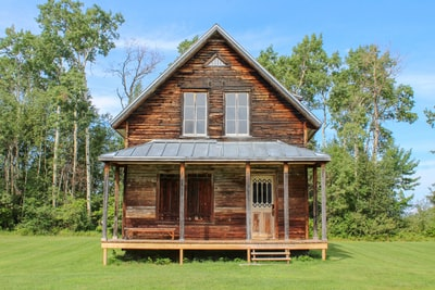 brown wooden 2-storey house during daytime log cabin zoom background