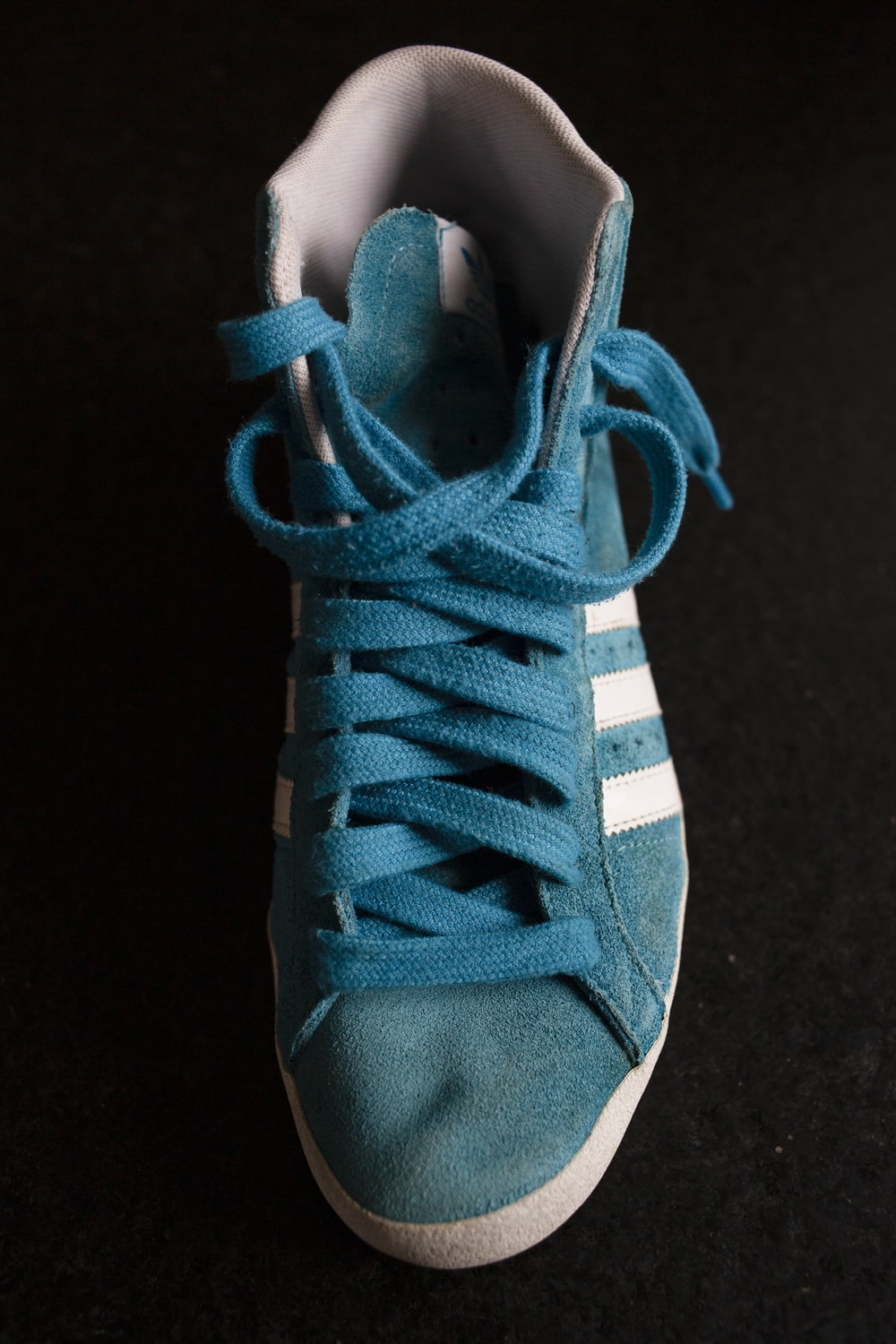 unpaired blue and white lace-up sneaker