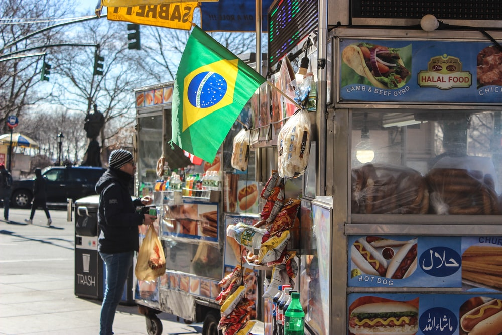 man standing on food stall