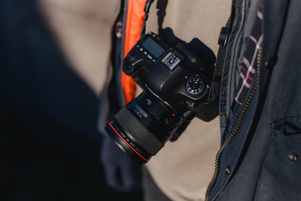 selective focus photography of black DSLR camera