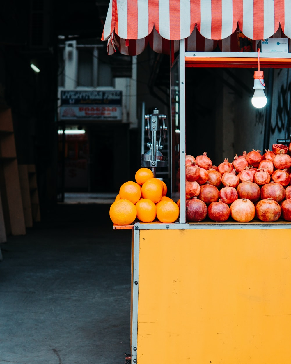 pomegranates and oranges on fruit stall