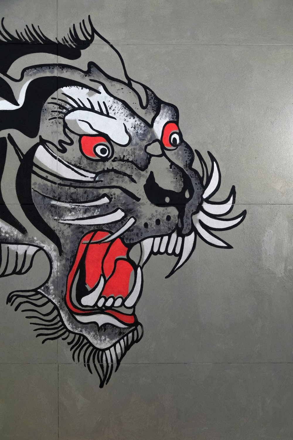 gray, black, and white tiger art on wall