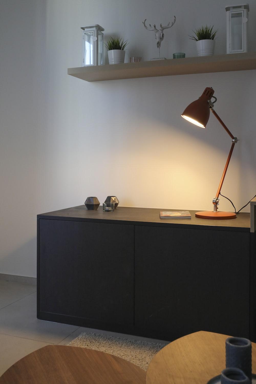 black wooden desk and brown desk lamp