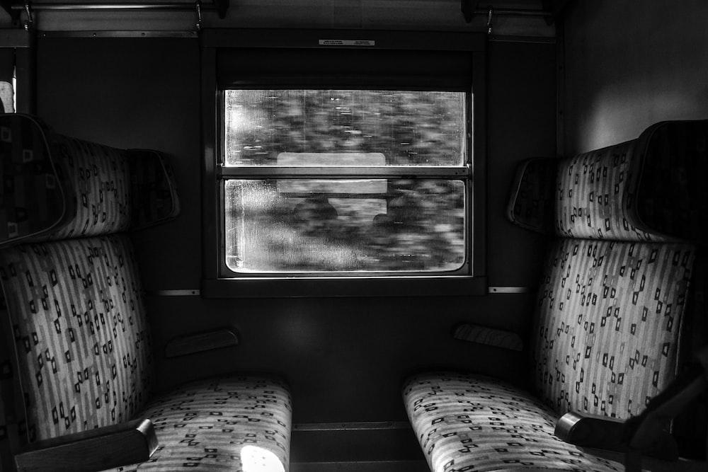grayscale photo of train seat