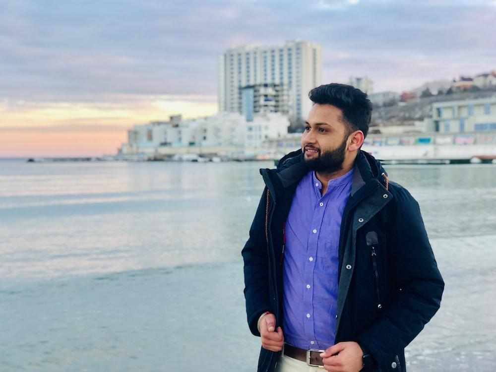 man walking nearby seashore