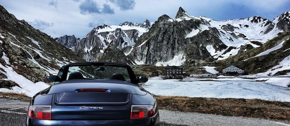 blue Porsche Carrera convertible coupe