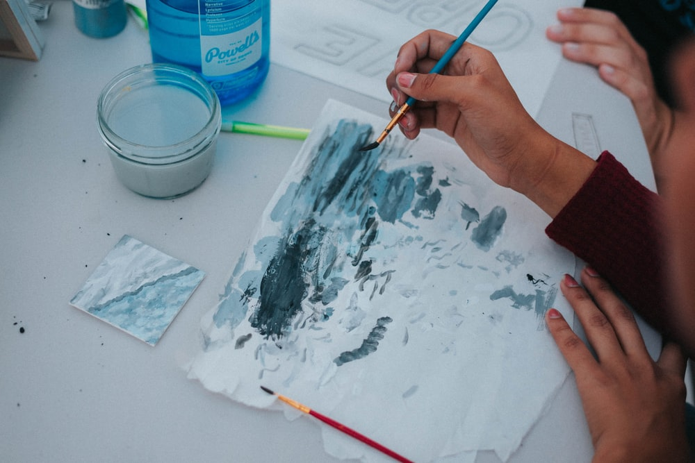 person using blue water color