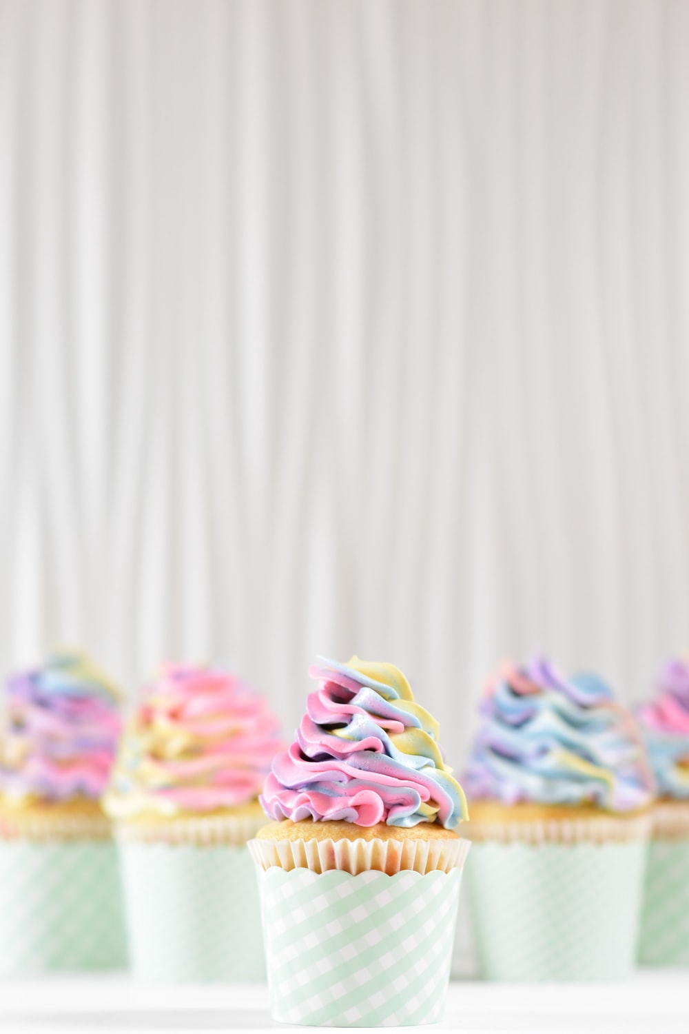 frosting on two cupcakes