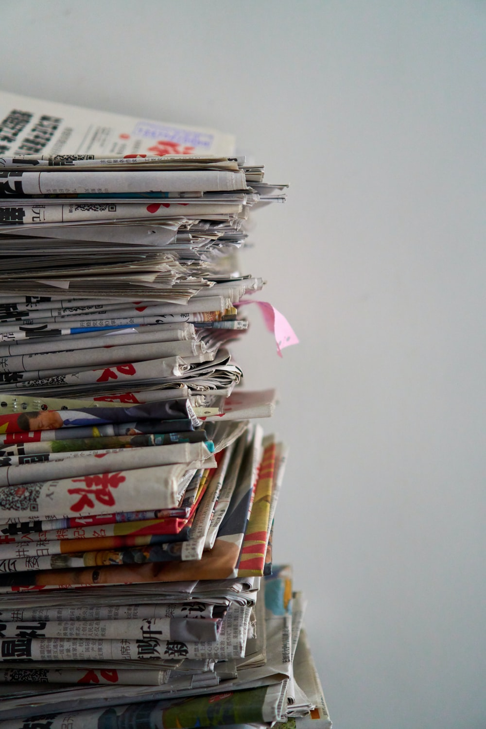 assorted newspapers on top of table