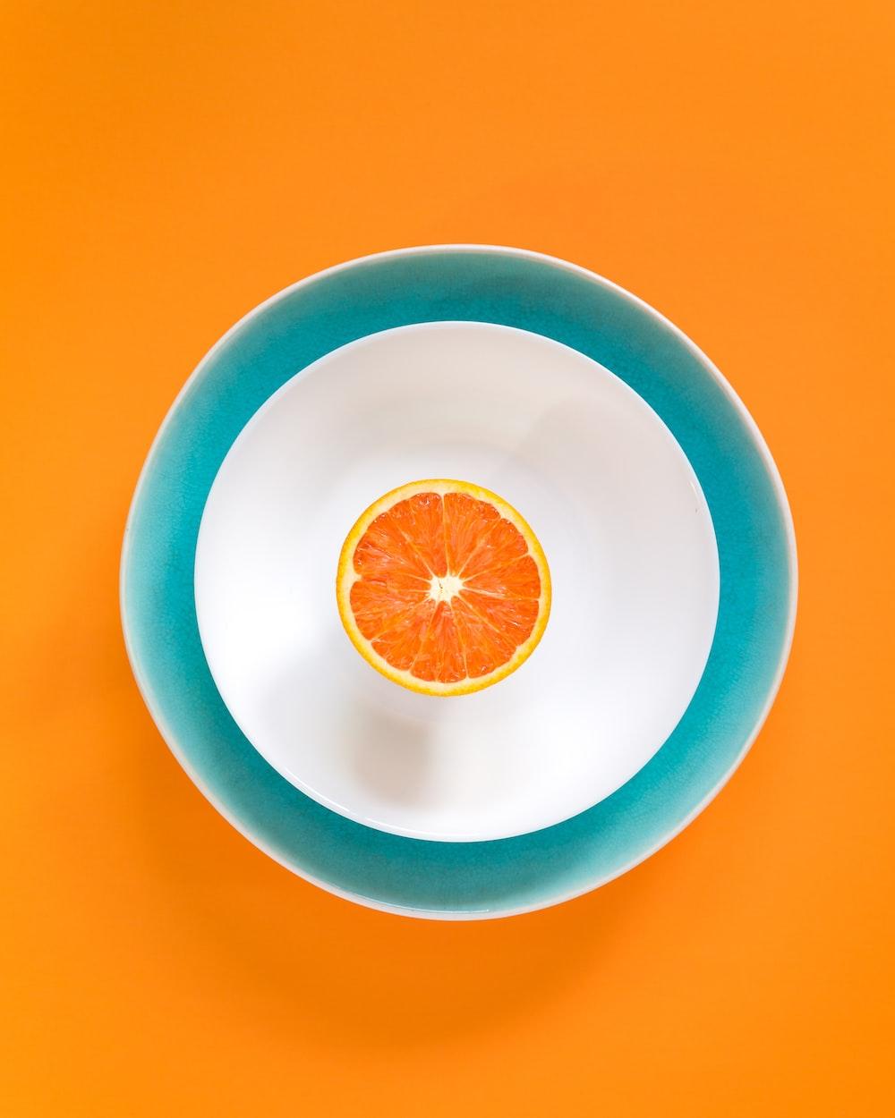 sliced orange fruit in bowl