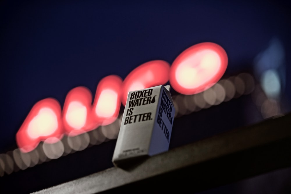 selective focus photography of boxed water box on table