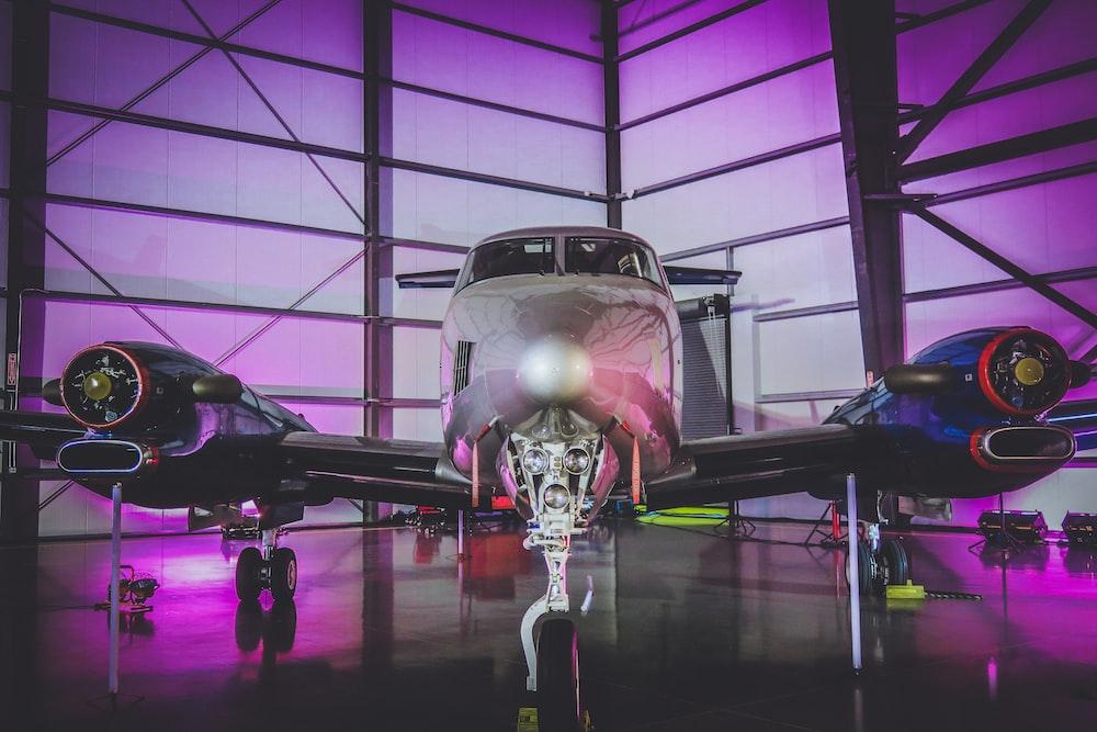 white private jet in hangar