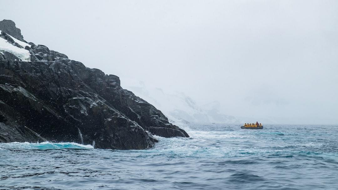 Quark Expeditions Zodiac excursion exploring the rocky shores of Spert Island (Antarctic Peninsula)