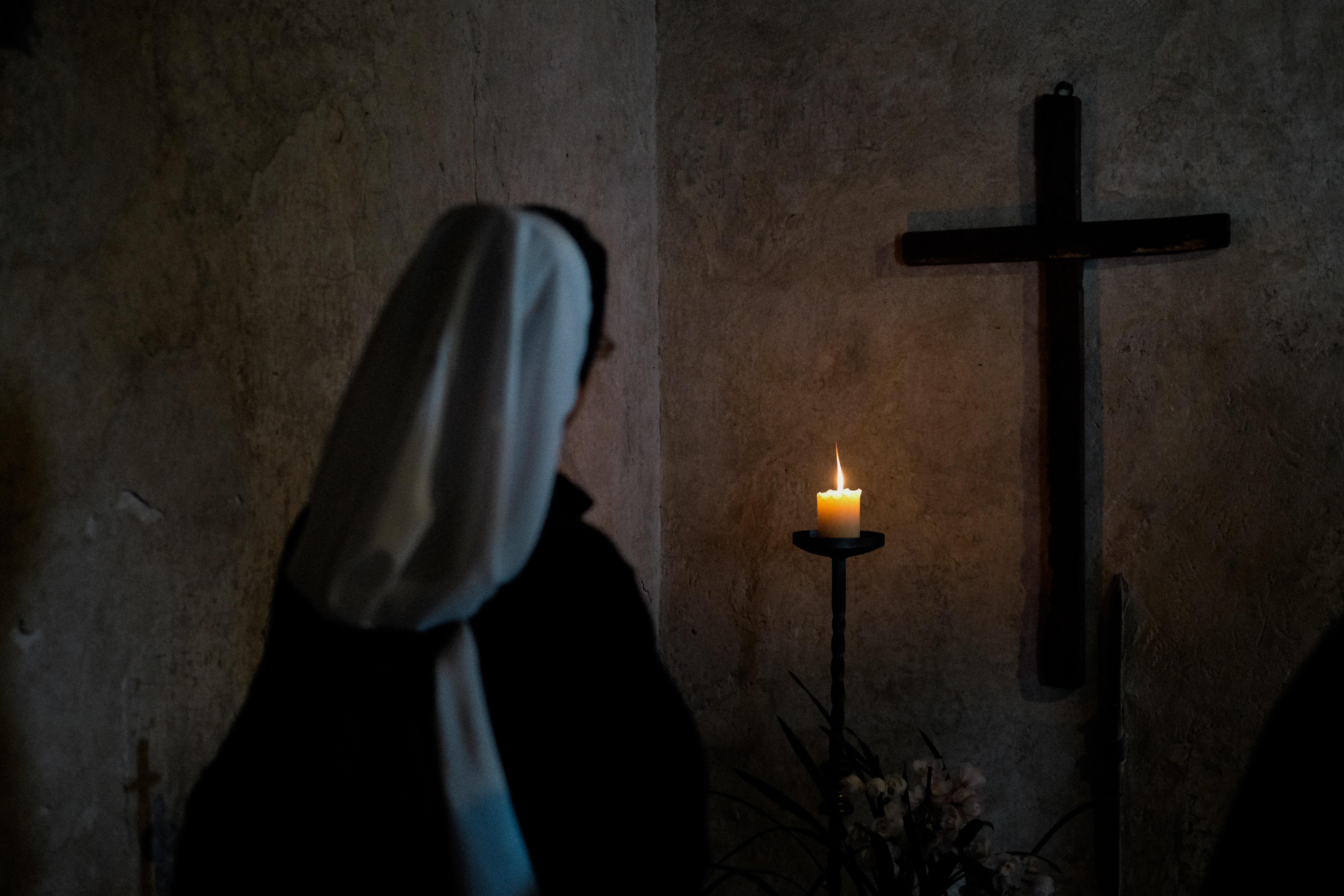 nun inside prayer room