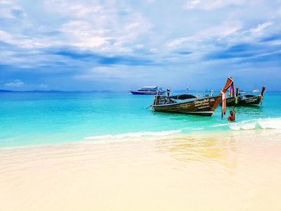 two brown boats on seashore phuket zoom background