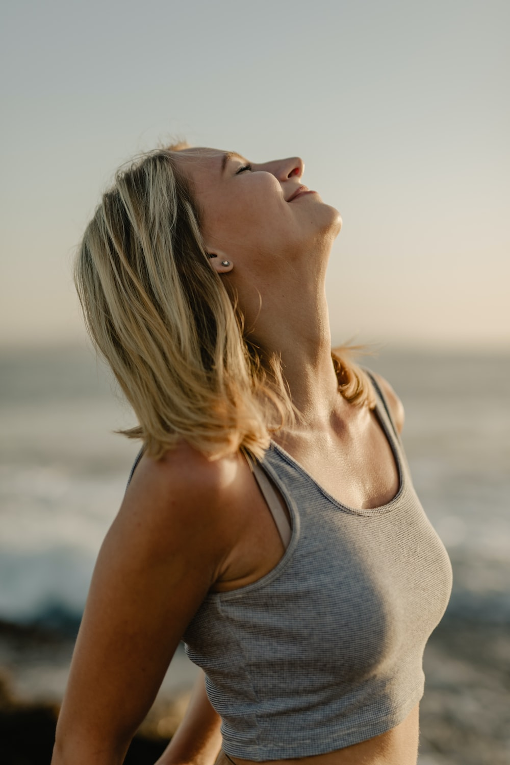 woman closing eyes while looking up