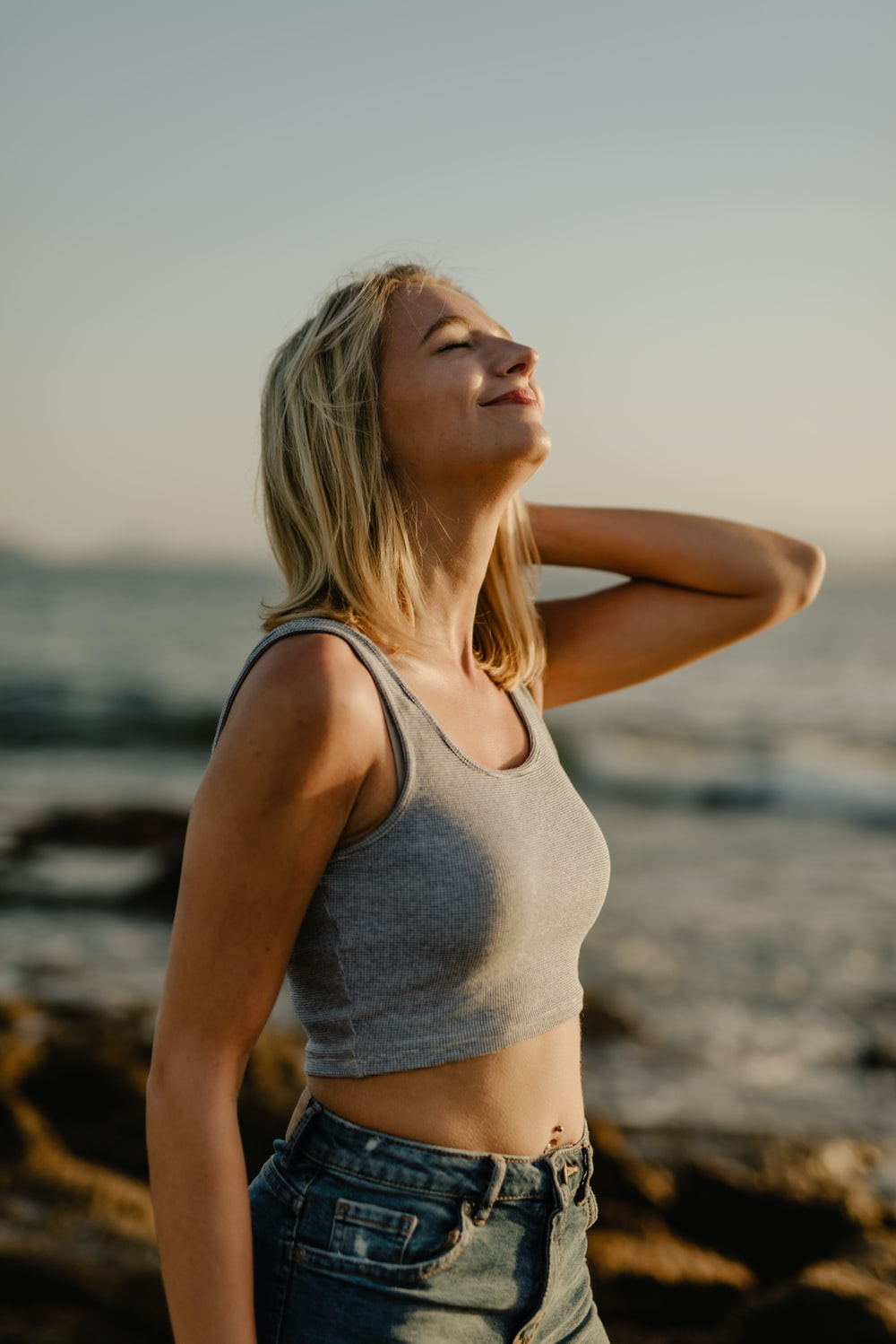 selective focus photography of woman wearing crop top