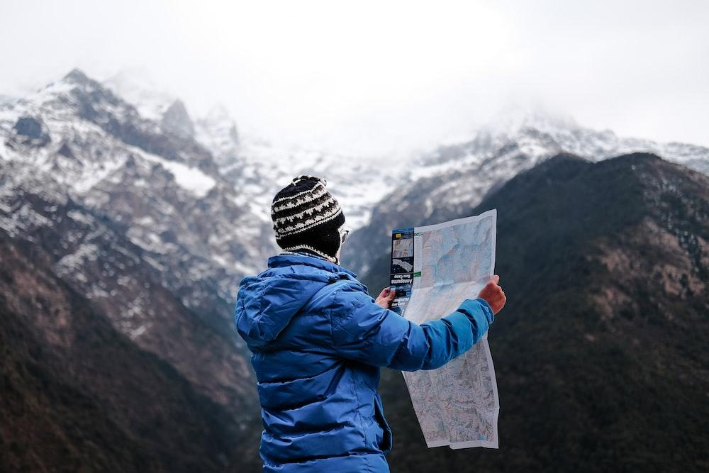 man holding map