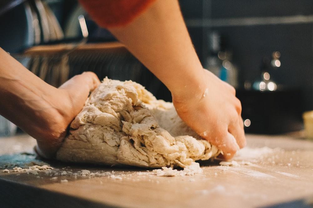 person mixing dough