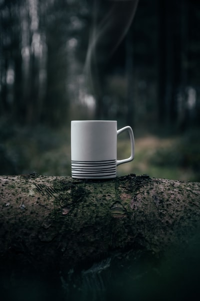 white ceramic mug on grey surface