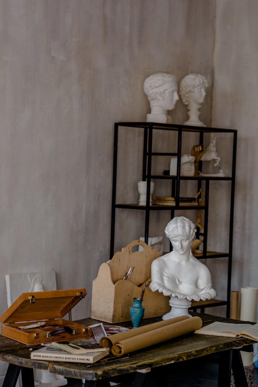 sculptures on top of shelf