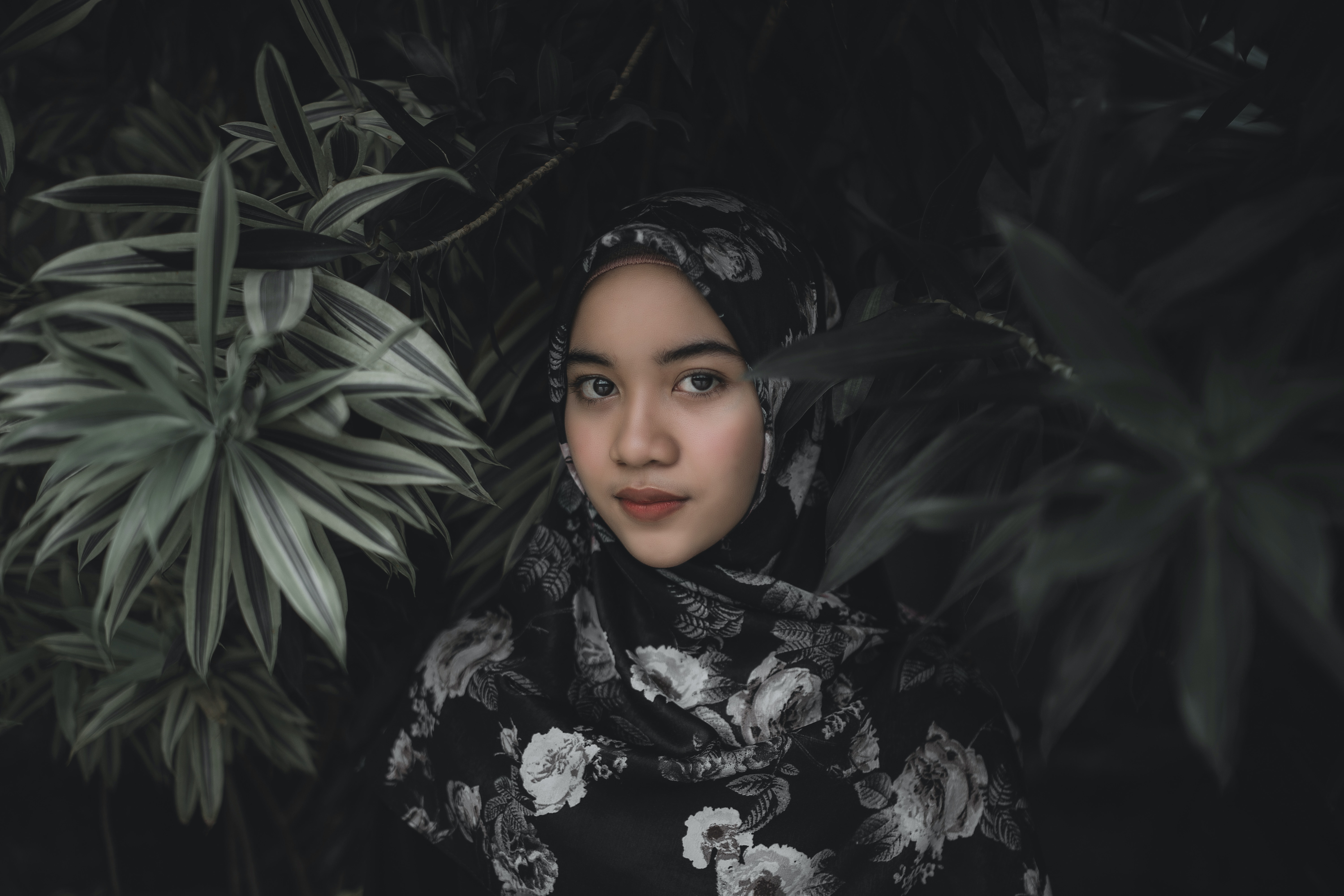 woman in black and white floral scarf