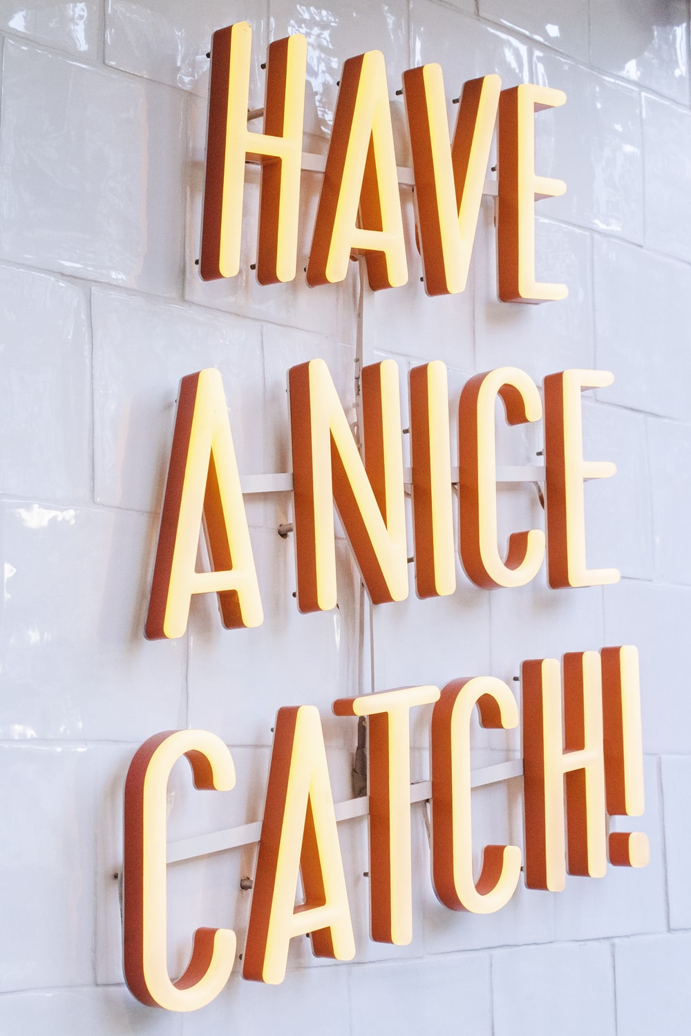 orange Have a Nice Catch! neon signage