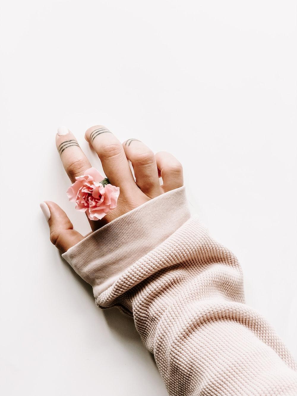 woman wearing rose ring