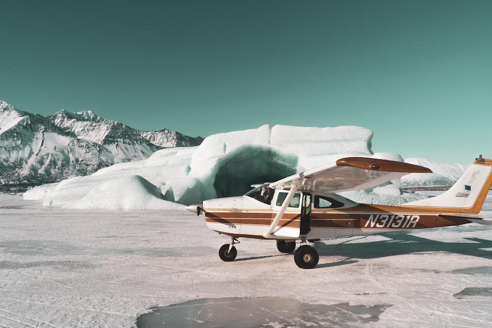 monoplane on snowy peak