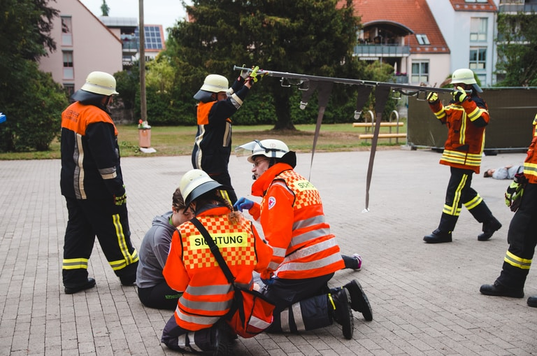 firemen performing drill outdoors