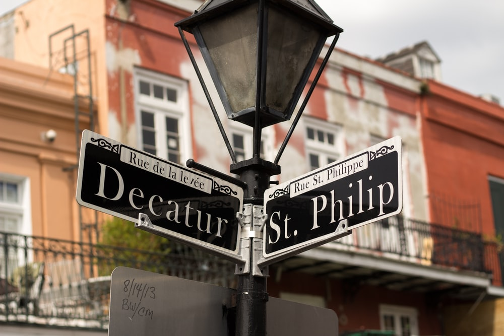 Decatur and St. Philip street signs on lamppost