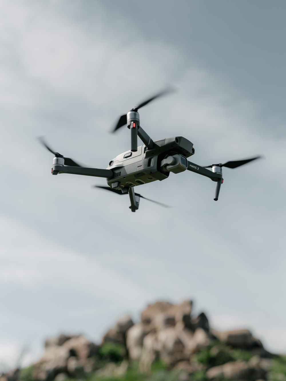 gray quadcopter flying