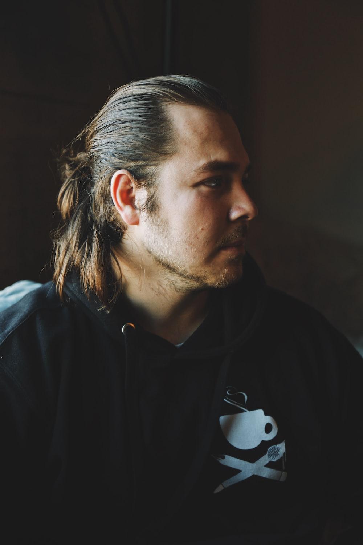 man in black hooded jacket