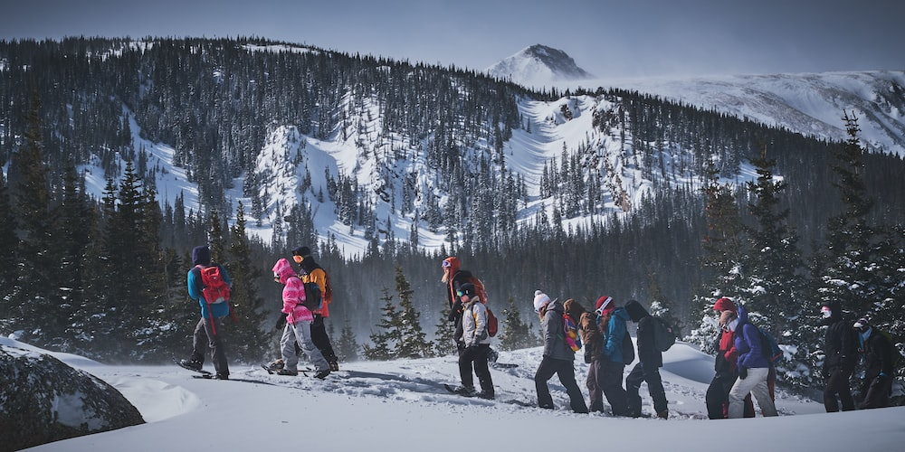 people walking on icy moutnain