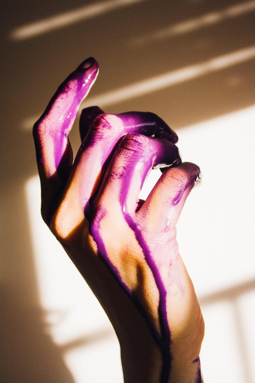 purple paint on hand