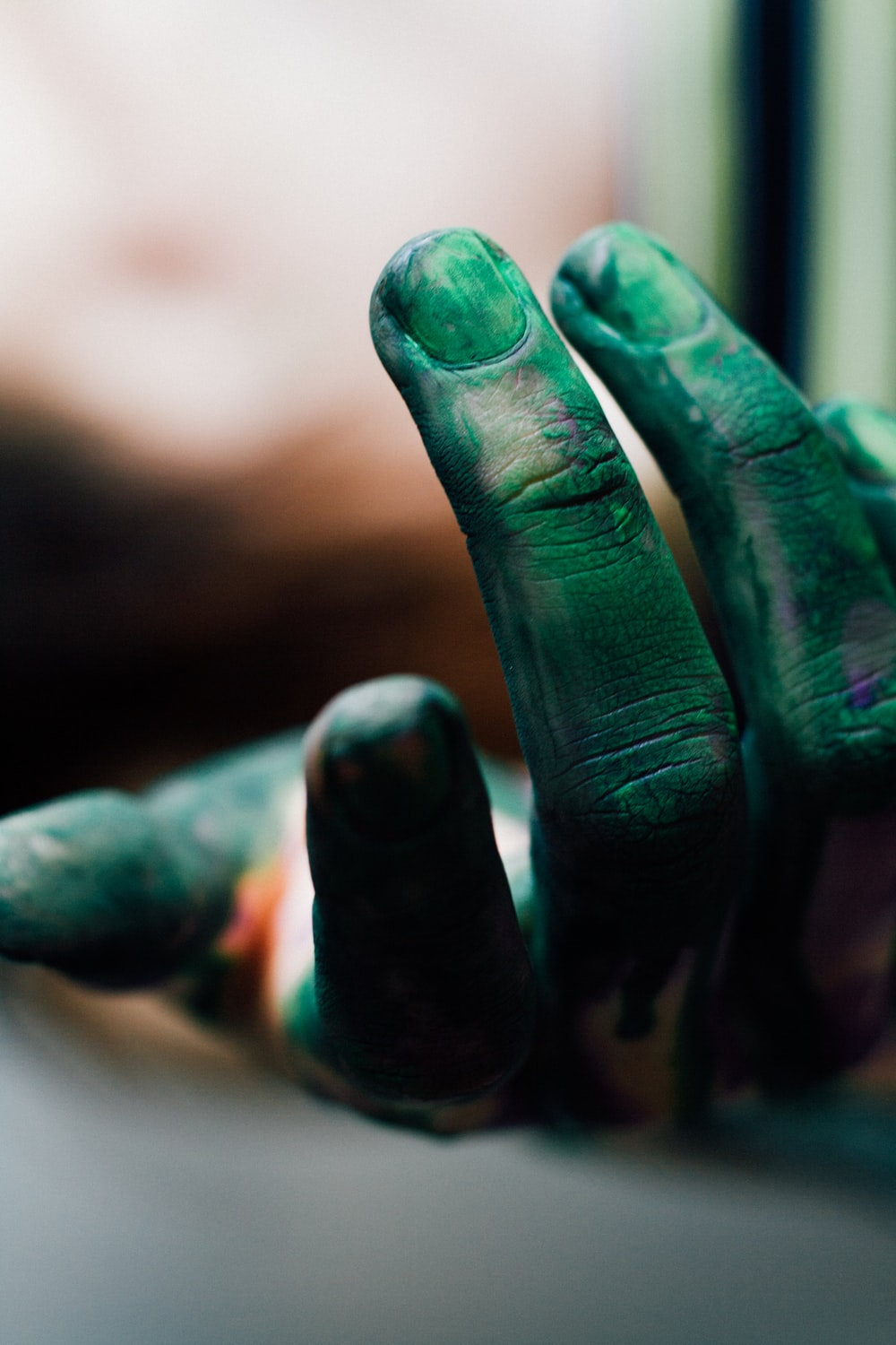 human hand with green paint