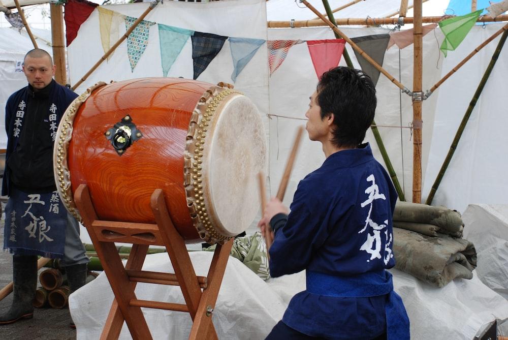 man playing taiko drum