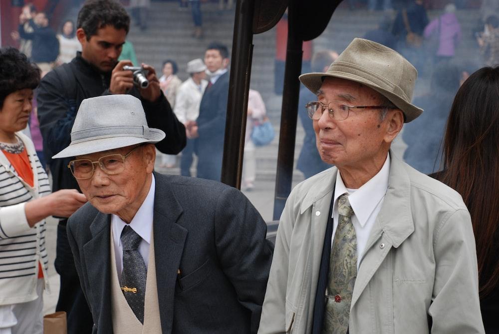 two man wearing suit