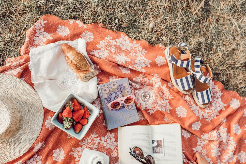 top angle photography of strawberries beside book