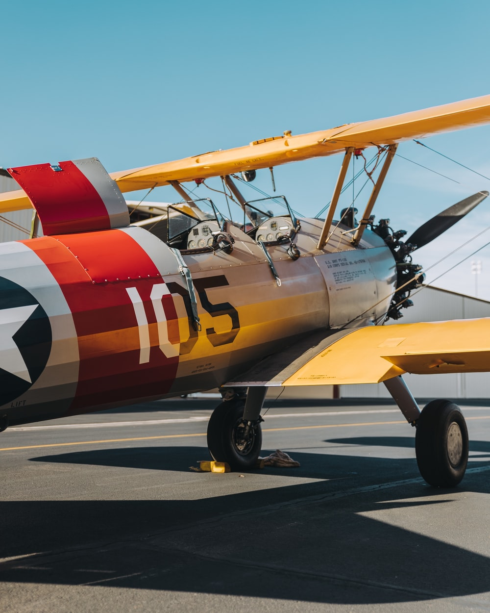 yellow, red, and white biplane