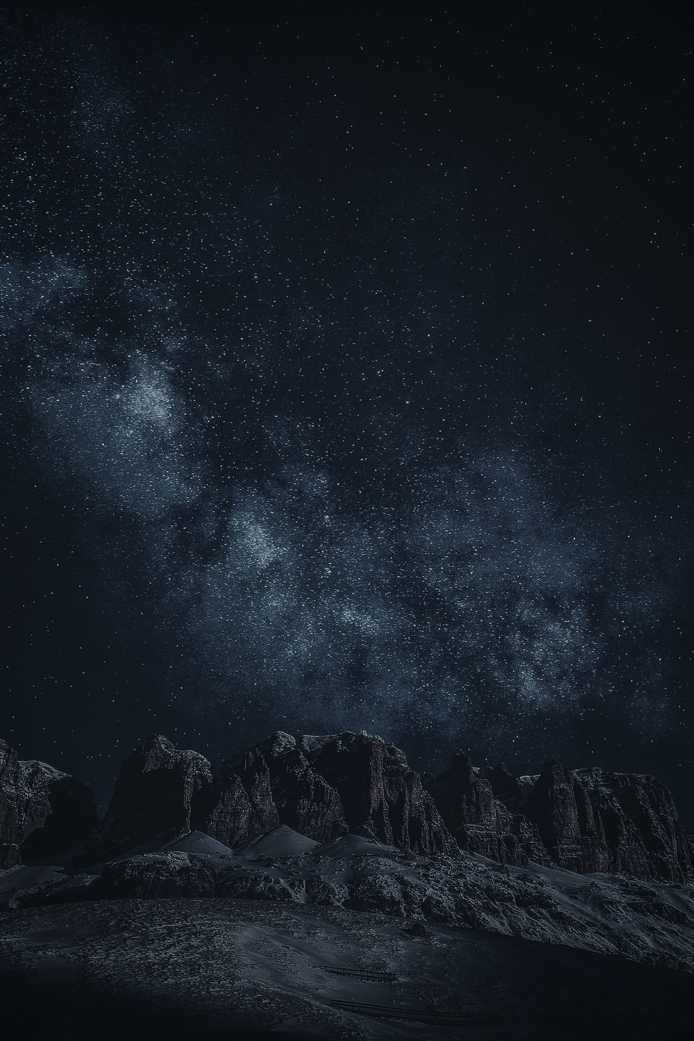 black rock formation during night time