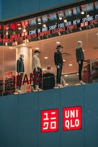 four mannequins inside Uniqlo store