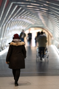 woman walking at tunnel