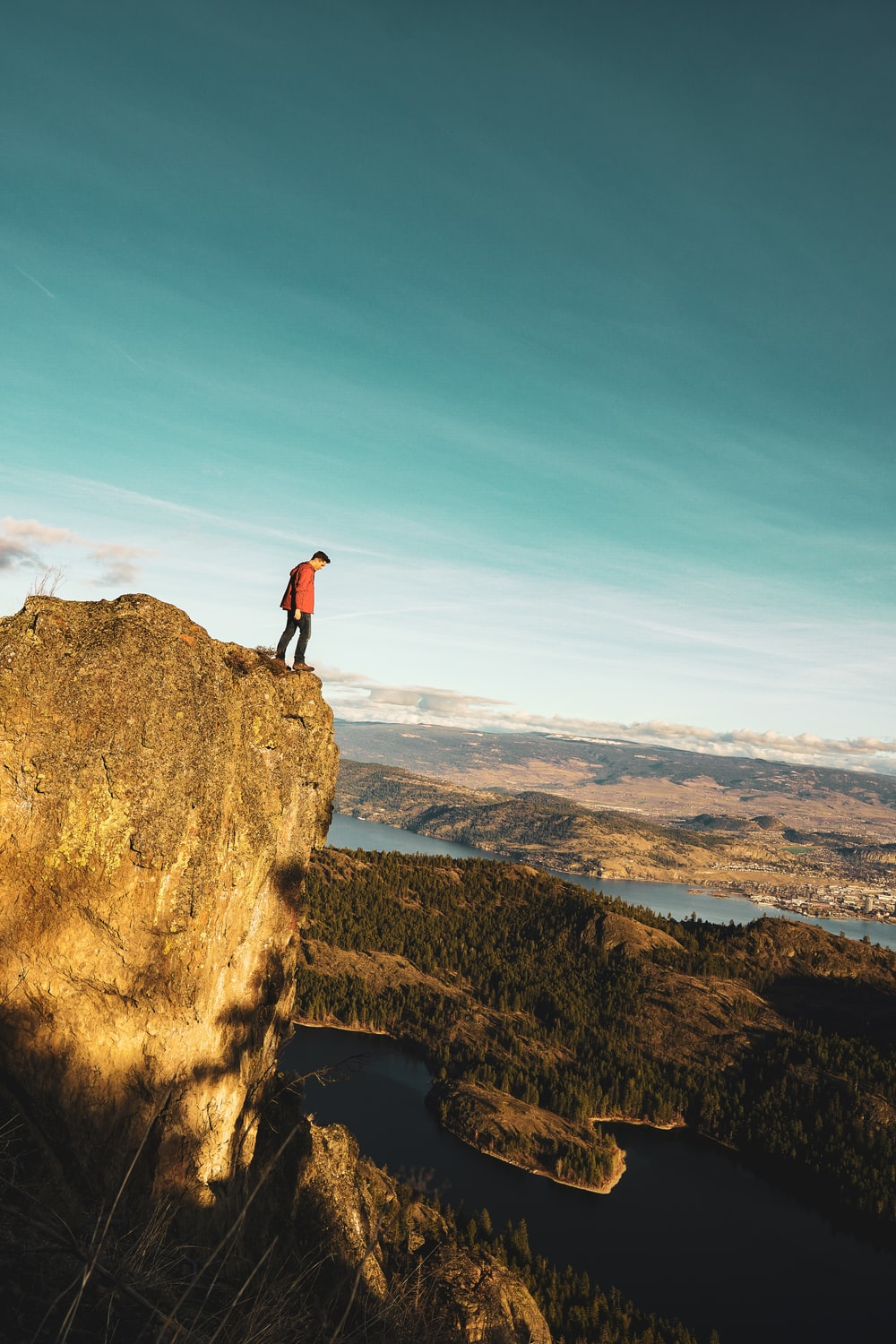 man standing on moutnain edge