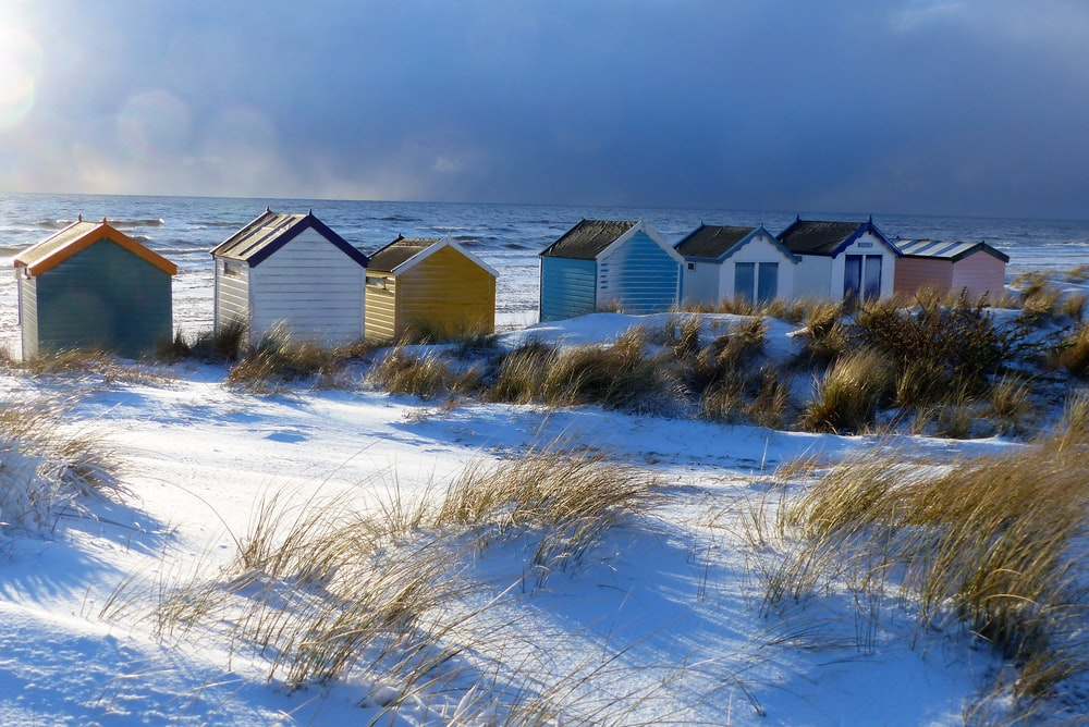assorted-color of houses on snow field