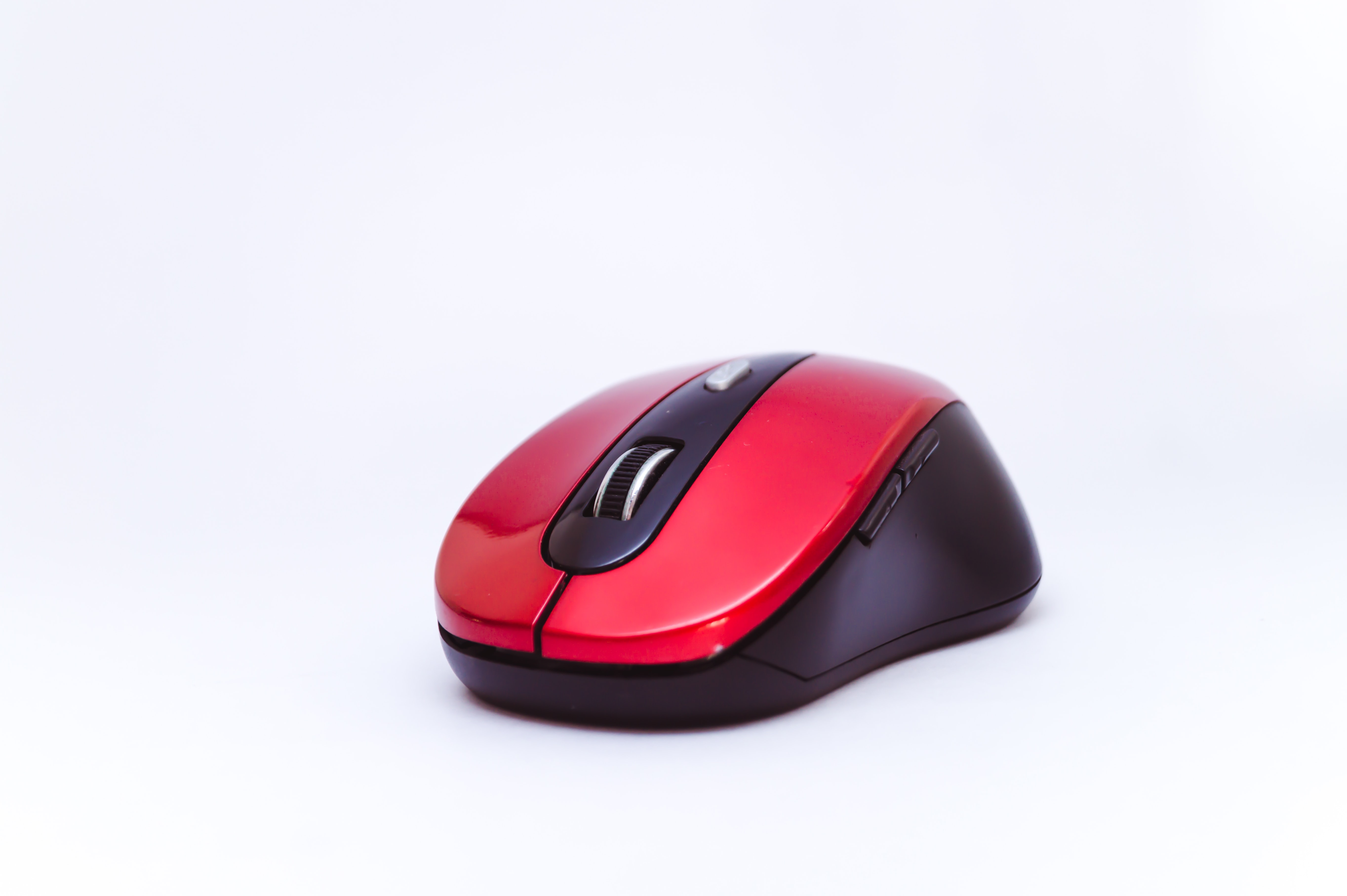 black and red cordless computer mouse