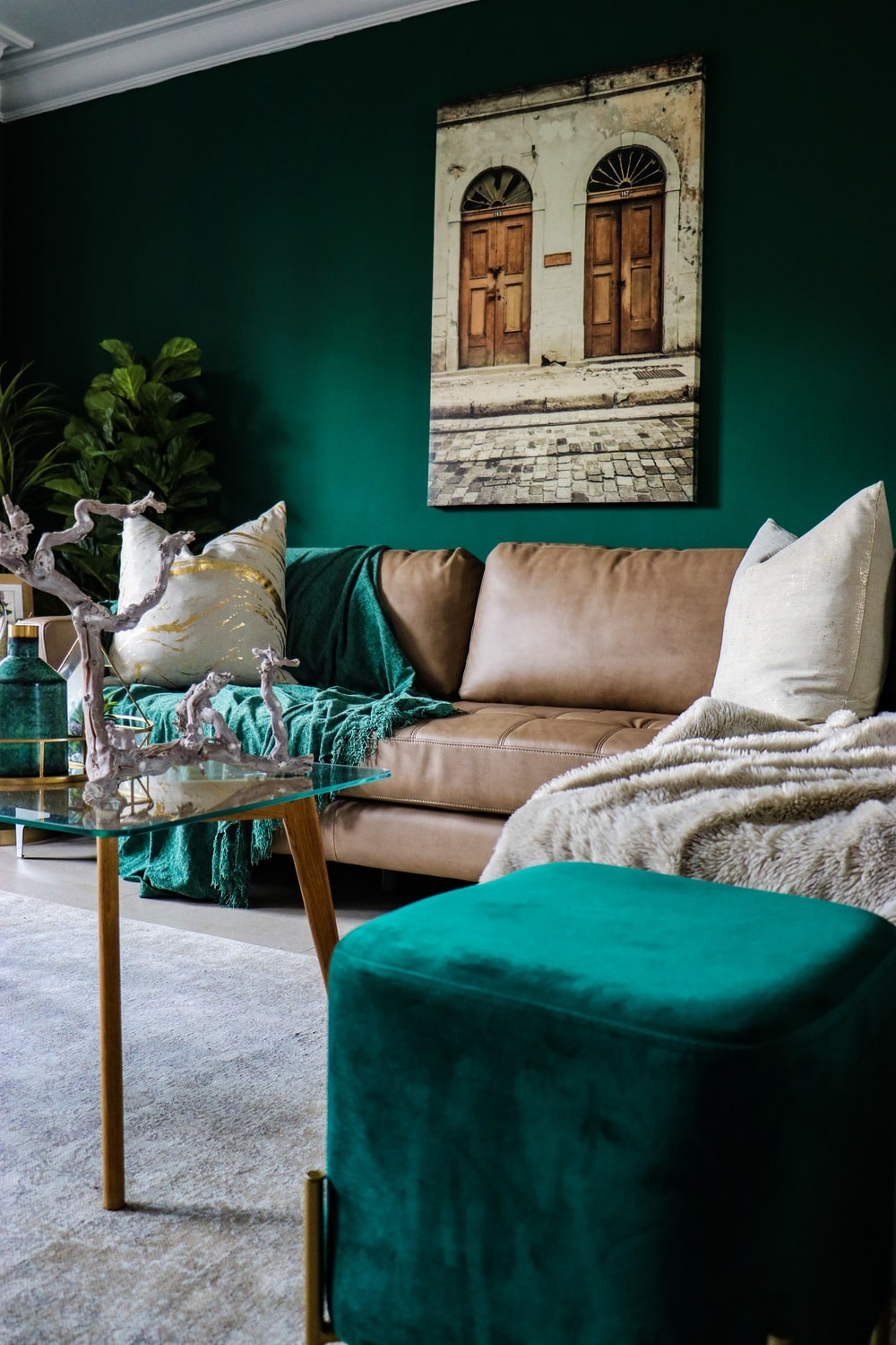 beige leather couch and green ottoman